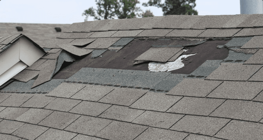 Close-up of a broken shingle roof