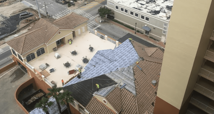 Birds-eye view of a building with a roof under construction
